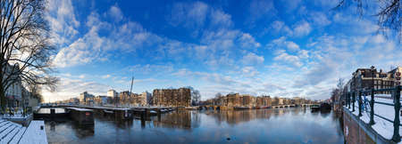 Beautiful 180 degree panorama of the river Amstel with the skinny bridge in Amsterdam, the Netherlands