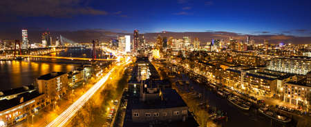 maas: Beautiful aerial view of the skyline of Rotterdam, the Netherlands, at twilight Stock Photo