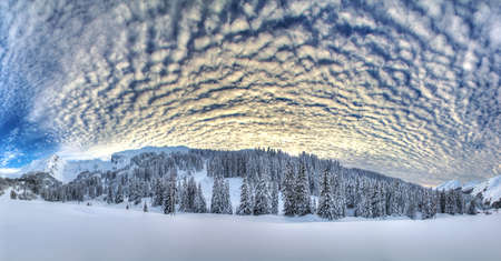 Beautiful 180 degree HDR panorama in the European Alps with a fantastic cloudscape photo