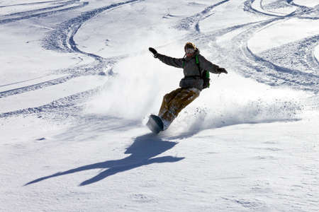 Snowboarder is having fun in the backcountry powder in the Italian Alps photo