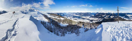 Beautiful 180 degree winter panorama on top of a mountain in the Italian alps on a sunny day Stock Photo
