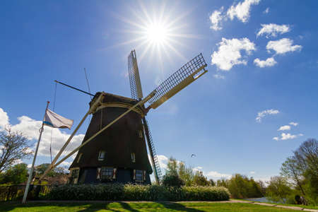 Dutch windmill the  Riekermolen  near the Amstel park in Amsterdam, the Netherlands photo