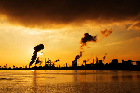 Sunset view of the heavy industry with smoking chimneys in IJmuiden, the Netherlands photo