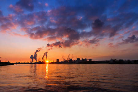 Silhouette of a big cargo ship and industry at sunset in IJmuiden in the Netherlands photo
