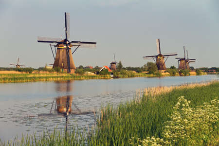 Beautiful image of the dutch windmills at Kinderdijk in the Netherlands photo