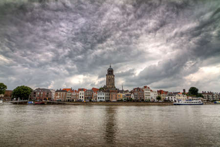 ijssel: Beautiful cityscape of the city of Deventer in the Netherlands, seen from across the river IJssel   Stock Photo
