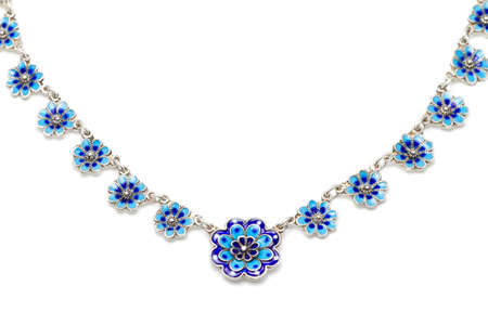 vitreous: Antique silver, blue vitreous enamel necklace in the shape of little flowers against a white background