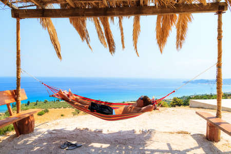 Young man relaxing in a hammock on the island of Zakynthos, Greece
