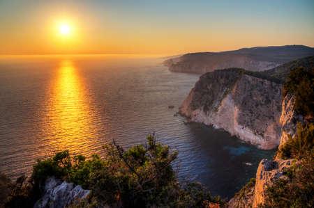 Beautiful sunset at the cliffs of Keri on the island Zakynthos photo