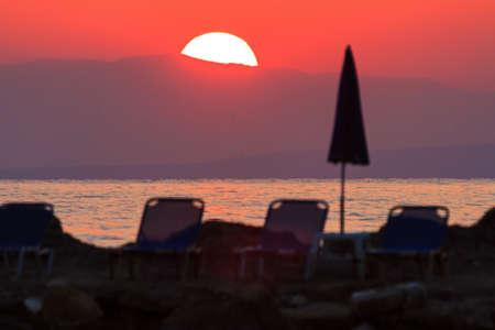 telezoom: Telezoom photo of a beautiful sunrise sunset on the beach on the island Zakynthos, Greece