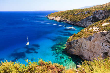 Luxurious vessels in a bay on the island of Zakynthos with beautiful blue waters photo