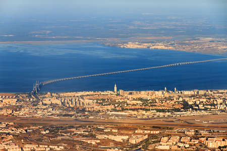 Vasco da gama bridge  and tower  in Lisbon, Portugal, seen from the sky photo