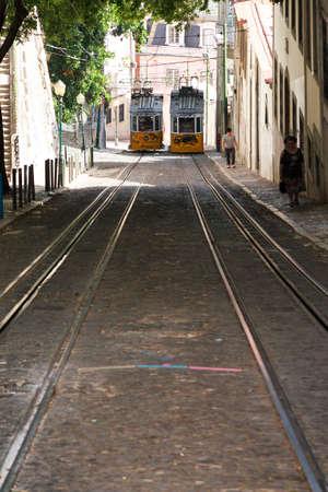 gloria: Steep street Calcada da Gloria with traditional trams in Lisbon, Portugal