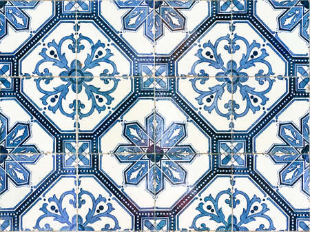 Close up image of the beautifully decorated tiles on the houses in the streets of Lisbon, Portugal photo