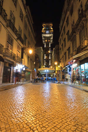 justa: Lisbon night street scene with the Santa Justa elevator in Lisbon, Portugal Stock Photo