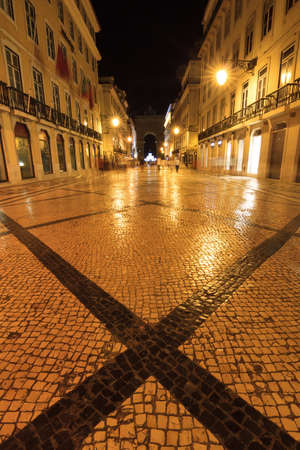 augusta: Night scene of the Rua Augusta and its cobblestones in Lisbon, Portugal