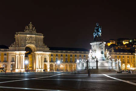 View on the gate on the Commerce square  Praca do Comercio  and the statue of King Jose at night in Lisbon, Portugal photo