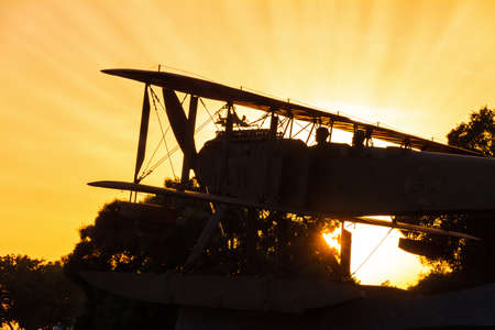 Beautiful silhouette of a biplane monument at sunset in Lisbon, Portugal photo
