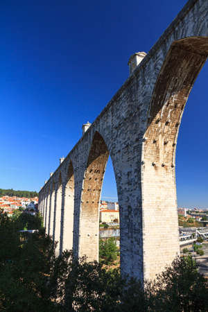 Beautiful view of the Aguas Livres Aqueduct on a summer day in Lisbon, Portugal photo