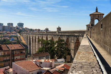 Beautiful view from the Aguas Livres Aqueduct on a summer day in Lisbon, Portugal photo