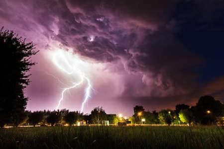 Beautiful big flash of lightning in the night sky over Baambrugge in the Netherlands Reklamní fotografie