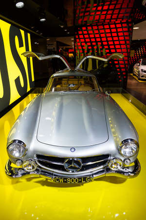 champs elysees: Mercedes 300 SL Gullwing in the iconic stars showroom on the Champs Elysees in Paris, France, on February 20, 2014 Editorial