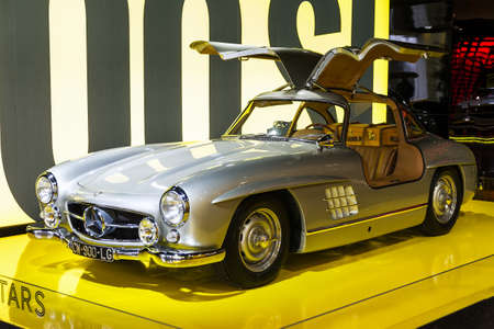 elysees: Mercedes 300 SL Gullwing in the iconic stars showroom on the Champs Elysees in Paris, France, on February 20, 2014 Editorial