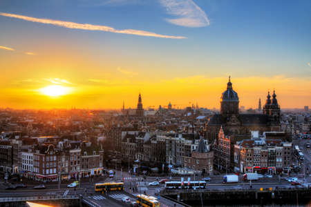 Sunset cityscape in winter of the skyline of Amsterdam, the Netherlands  HDR photo