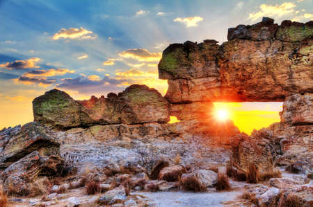 Sunset at the famous rock formation  La Fenetre  near Isalo, Madagascar  HDR 스톡 콘텐츠