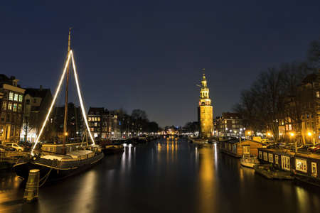 Night shot of the  Oudeschans  and the 16th century  Montelbaanstoren  in Amsterdam, The Netherlands