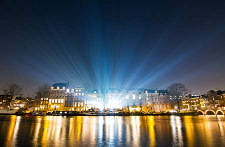 amstel: Lightshow over the river Amstel at the canals of Amsterdam, The Netherlands