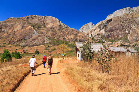 Tourist visiting Anja reserve national park in Madagascar on a beautiful day Editorial