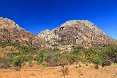 Beautiful landscape of Madagascar with massive granite rocks and a blue sky