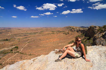 Tourist looking out over the beautiful landscape of Isalo national park in Madagascar photo