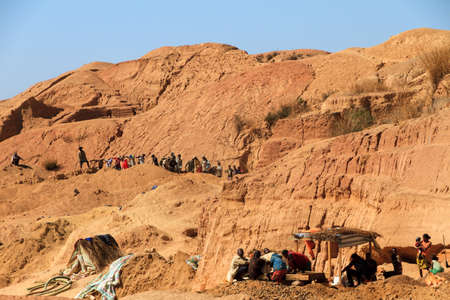 underpaid: Local people working in the sapphire (and other gemstones) mine in Ilakaka, Madagascar, on September 10, 2013 Editorial