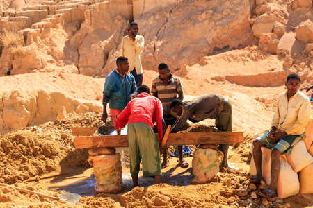 inhumane: Local people working in the sapphire (and other gemstones) mine in Ilakaka, Madagascar, on September 10, 2013 Editorial