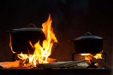 Pots and pans on the stove over a natural fire for cooking photo