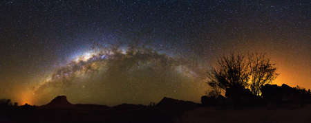 Extraordinary 180 degree nightscape panorama with the milky way seen from Isalo, Madagascar photo