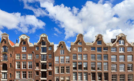prinsengracht: Beautiful dutch canal houses at the prinsengracht in Amsterdam the Netherlands with a blue sky and a nice cloudscape Editorial