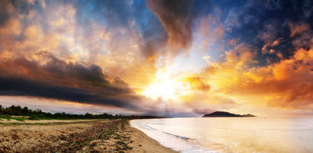 colorful cloudscape: Beautiful panorama of the coastline of Maroantsetra in Madagascar at sunrise with a dramatic sky and cloudscape Stock Photo