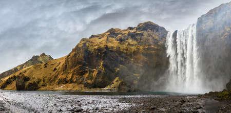 skogafoss waterfall: Beautiful 180 degree panorama of the magnificent Skogafoss waterfall in Iceland Stock Photo