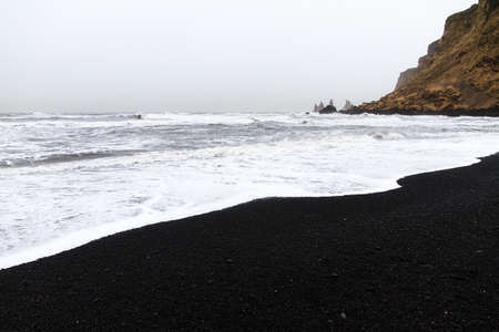 rough sea: Beautiful winter view of the black sand and rough sea at the beach of Vik in Iceland Stock Photo