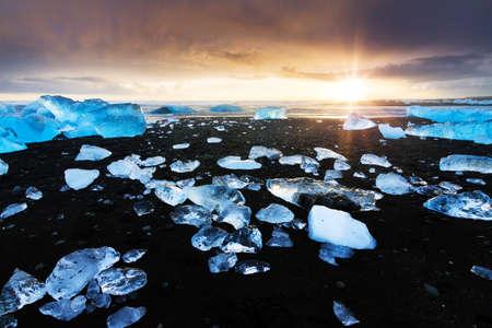 jokulsarlon: Beautiful beached chunks of ice at the beach at Jokulsarlon, Iceland, at sunset in winter Stock Photo