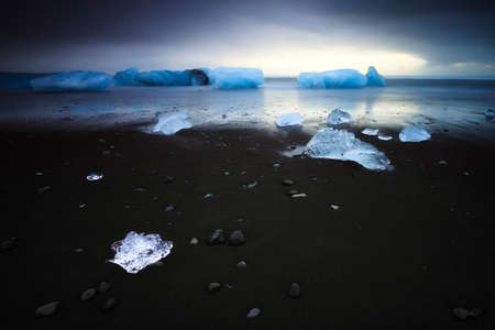 beached: Beautiful beached chunks of ice at the beach at Jokulsarlon, Iceland, in winter