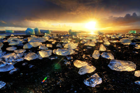 beached: Beautiful beached chunks of ice at the beach at Jokulsarlon, Iceland, at sunset in winter. HDR