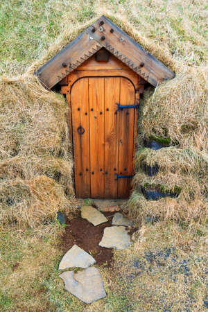 over grown: Beautiful grass over grown entrance door to a turf church in Iceland