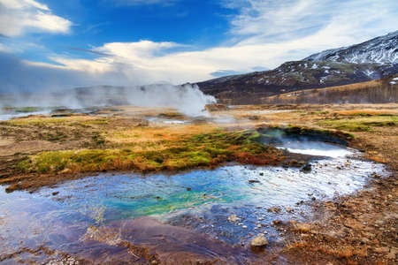 golden: The colorful geyser landscape at the Haukadalur geothermal area, part of the golden circle route, in Iceland