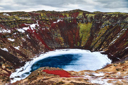 crater lake: Kerid or Kerith volcanic crater lake on the touristic golden circle route in Iceland in winter