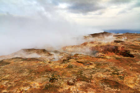 powerplant: Colorful geothermal area Gunnuhver, with steam vents and a geothermal powerplant, in Iceland Stock Photo
