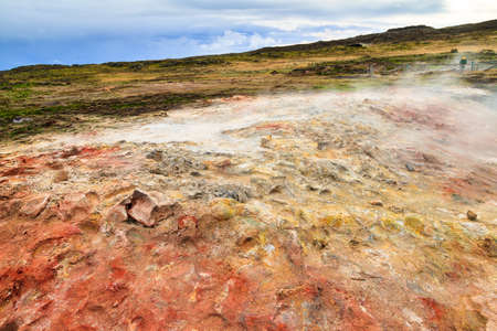 vents: Colorful geothermal area Gunnuhver, with steam vents and a geothermal powerplant, in Iceland Stock Photo